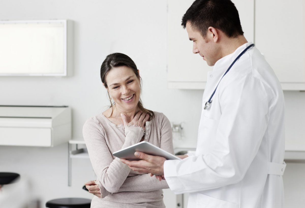 Doctor showing tablet screen to patient